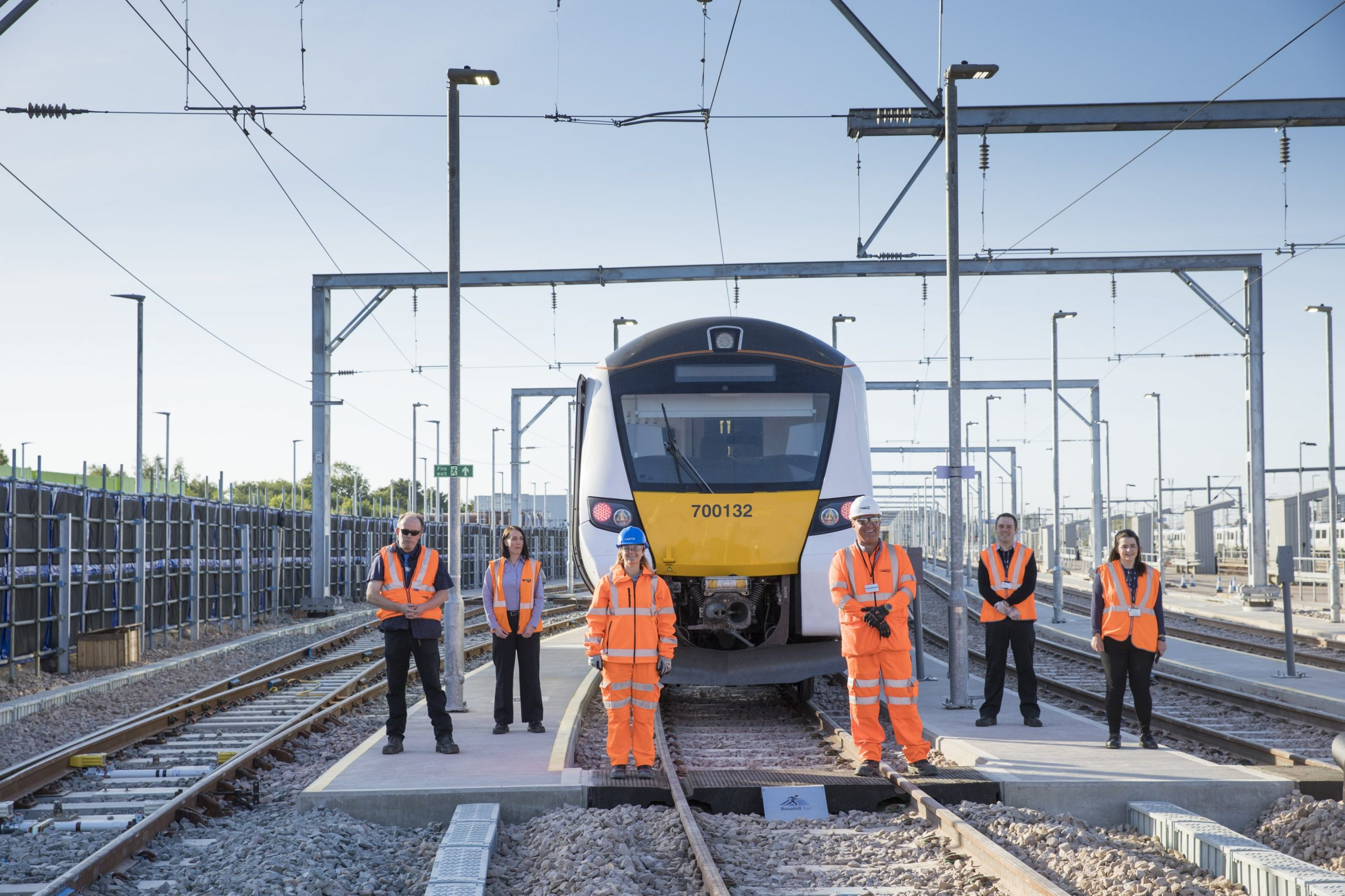 Team celebrate railway sidings opening as first train arrives